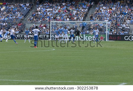 New York, NY - August 1, 2015: Laurent Ciman (23) performs free kick during game between New York City FC and Montreal Impact at Yankee Stadium