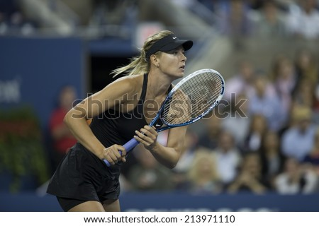 NEW YORK, NY - AUGUST 29, 2014: Maria Sharapova of Russia returns ball during 2nd round match against Sabine Lisicki of Germany at US Open tennis tournament in Flushing Meadows USTA Tennis Center - stock photo