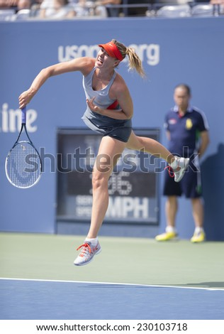 NEW YORK, NY - AUGUST 31, 2014: Maria Sharapova of Russia serves ball during 4th round match against Caroline Wozniacki of Denmark at US Open tennis tournament in Flushing Meadows USTA Tennis Center