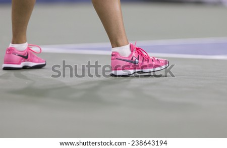 NEW YORK, NY - AUGUST 25: Maria Sharapova of Russia wears Nike sneakers during 1st round match against Maria Kirilenko of Russia at US Open tennis tournament in Flushing Meadows USTA Tennis Center 2014 - stock photo