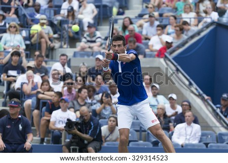 New York, NY - August 31, 2015: Novak Djokovic of Serbia returns ball during 1st round match against Joao Souza of Brazil at US Open Championship