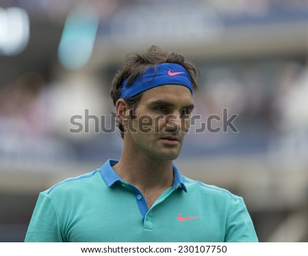 NEW YORK, NY - AUGUST 31, 2014: Roger Federer of Switzerland reacts during 3rd round match against Marcel Granollers of Spain at US Open tennis tournament in Flushing Meadows USTA Tennis Center - stock photo