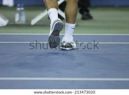 NEW YORK, NY - AUGUST 26: Roger Federer of Switzerland shows Nike Air Jordan sneakers during 1st round match against Marinko Matosevic of Australia at US Open in Flushing Meadows USTA Tennis Center - stock photo