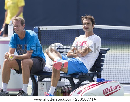 NEW YORK, NY - AUGUST 31, 2014: Roger Federer of Switzerland & Stefan Edberg during practive session at US Open tennis tournament in Flushing Meadows USTA Tennis Center - stock photo