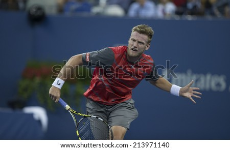 NEW YORK, NY - AUGUST 29, 2014: Sam Groth of Australia returns ball during 2nd round match against Roger Federer of Switzerland at US Open tennis tournament in Flushing Meadows USTA Tennis Center - stock photo