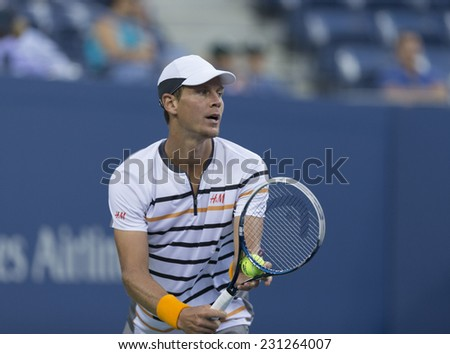 NEW YORK, NY - AUGUST 29, 2014: Tomas Berdych of Czech Republic serves ball during 2nd round match against Martin Klizan of Slovakia at US Open tennis tournament in Flushing Meadows USTA Tennis Center