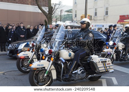 NEW YORK, NY - DECEMBER 27, 2014: Police officer on Motorcycle from Philadelphia attends Christ Tabernacle Church for the funeral of slain New York City Police Officer Rafael Ramos - stock photo