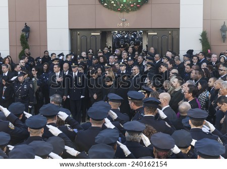 NEW YORK, NY - DECEMBER 27, 2014: Police officers around the country gather outside of Christ Tabernacle Church for funeral of slain NYC Police Officer Rafael Ramos with widow Maritza Ramos & sons - stock photo