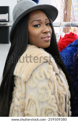 NEW YORK, NY - FEBRUARY 12: A guest attends the Helen Yarmak presentation during MBFW Fall 2015 at 730 Fifth Avenue on February 12, 2015 in NYC - stock photo