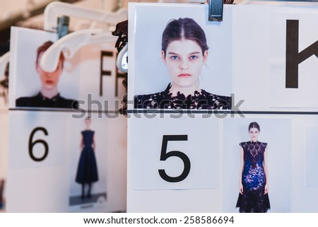 NEW YORK, NY - FEBRUARY 13: A model compcard backstage at the Nicole Miller fashion show during MBFW Fall 2015 at Lincoln Center on February 13, 2015 in NYC. - stock photo