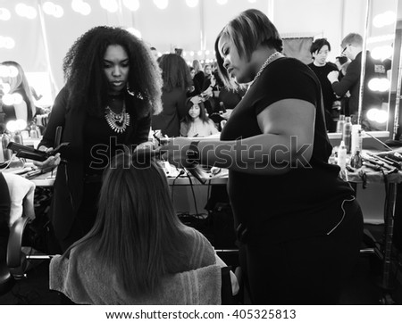 New York, NY - February 14, 2016: A model prepares backstage for the Custo Barcelona Fall 2016 fashion show during New York Fashion Week