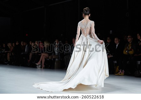 NEW YORK, NY - FEBRUARY 19: A model walks runway in Dany Tabet dress at the New York Life fashion show during MBFW Fall 2015 on February 19, 2015 in NYC. - stock photo