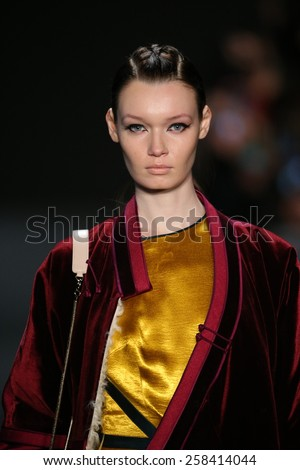 NEW YORK, NY - FEBRUARY 13: A model walks the runway at MONGOL fashion show during Mercedes-Benz Fashion Week Fall 2015 at Lincoln Center on February 13, 2015 in New York City - stock photo