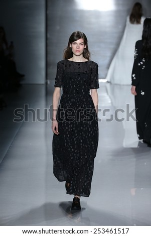 NEW YORK, NY - FEBRUARY 14: A model walks the runway at Noon by Noor fashion show during Mercedes-Benz Fashion Week Fall 2015 at Lincoln Center on February 14, 2015 in New York City