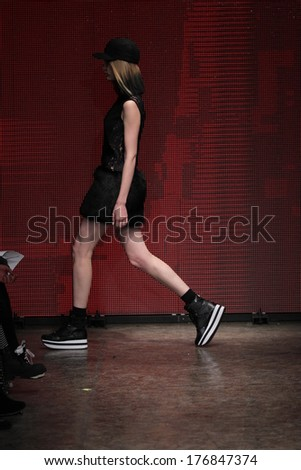 NEW YORK, NY - FEBRUARY 09: A model walks the runway at the DKNY Women's fashion show during Mercedes-Benz Fashion Week Fall 2014 on February 9, 2014 in New York City.