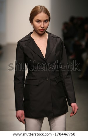 NEW YORK, NY - FEBRUARY 12: A model walks the runway at the Jungwon show during Nolcha Fashion Week FW 2014  on February 12, 2014 in NYC