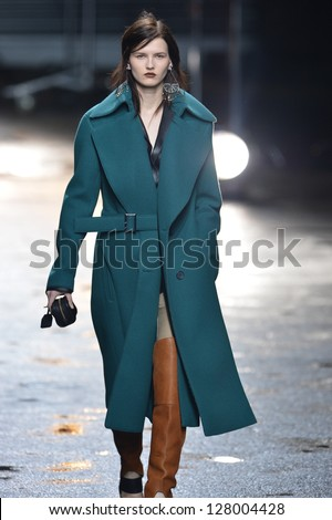 NEW YORK, NY - FEBRUARY 11: A model walks the runway at the 3.1 Phillip Lim fall 2013 fashion show during Mercedes-Benz Fashion Week on February 11, 2013 in New York City. - stock photo