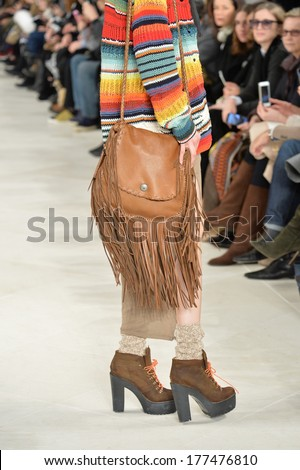 NEW YORK, NY - FEBRUARY 13: A model walks the runway at the Ralph Lauren fashion show during Mercedes-Benz Fashion Week Fall 2014 on February 13, 2014 in New York City. - stock photo