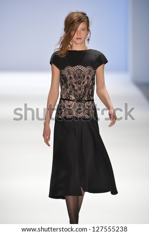 NEW YORK, NY- FEBRUARY 07: A model walks  the runway at the Tadashi Shoji  Collection for Fall/Winter 2013  during Mercedes-Benz Fashion Week on February 07, 2013 in NYC. - stock photo