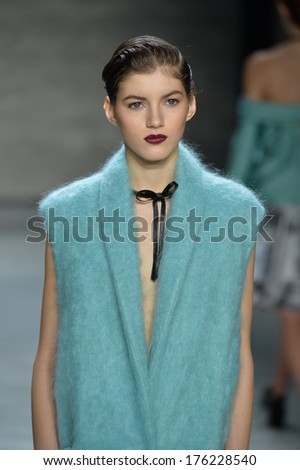 NEW YORK, NY - FEBRUARY 07: A model walks the runway at Zimmermann fashion show during Mercedes-Benz Fashion Week Fall 2014 at Lincoln Center on February 7, 2014 in New York City. - stock photo
