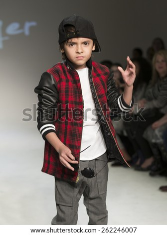 New York, NY - February 28, 2015: A model walks the runway for Dillonger collection by LaToia Fitzgerald during petitePARADE / Kids Fashion Week at Bathhouse Studios