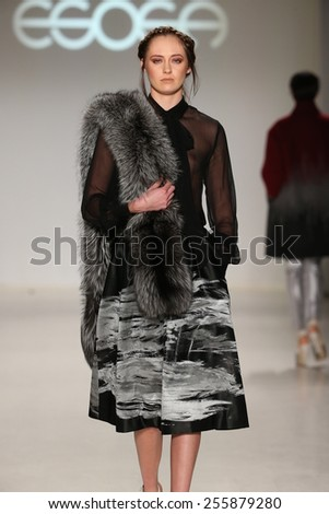 NEW YORK, NY - FEBRUARY 19: A model walks the runway in a design by Esosa at the New York Life fashion show during MBFW Fall 2015 at Lincoln Center on February 19, 2015 in NYC.