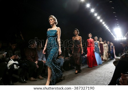 NEW YORK, NY - FEBRUARY 15: A model walks the runway wearing Di Yusupoff at Nolcha Shows During NYFW Women's Fall/Winter 2016 at ArtBeam on February 15, 2016 in New York City. - stock photo