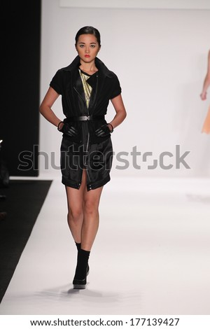NEW YORK, NY - FEBRUARY 13: A model walks the runway wearing Silkskin designer dress at the FLT Moda + Art Hearts Fashion show during Mercedes-Benz Fashion Week Fall 2014 on February 13, 2014 in NYC.