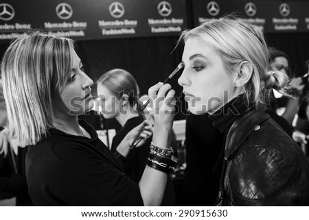 New York, NY - February 13, 2015: Becca Horn prepares backstage at the Nicole Miller Fall 2015 fashion show during Mercedes-Benz Fashion Week at The Salon at Lincoln Center - stock photo
