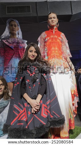 NEW YORK, NY - FEBRUARY 10, 2015: Designer Elisa Guillen & models show off dresses at Epson Digital Couture Presentation at Fall 2015 Mercedes-Benz Fashion Week at Industria Super Studio - stock photo