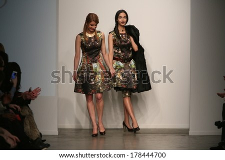 NEW YORK, NY - FEBRUARY 12: Designer L. Catherine and model walks the runway at the L. Catherine show during Nolcha Fashion Week FW 2014  on February 12, 2014 in NYC - stock photo