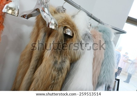 NEW YORK, NY - FEBRUARY 12: Fur coats on rack during Helen Yarmak presentation during MBFW Fall 2015 at 730 Fifth Avenue on February 12, 2015 in NYC - stock photo