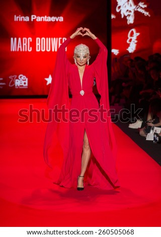 New York, NY - February 12, 2015: Irina Pantaeva in Marc Bouwer dress walks runway for the Heart Truth Red Dress Collection 2015 fashion show as part of Fall 2015 Mercedez-Benz Fashion Week