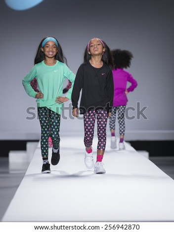 New York, NY - February 12,2015: Jesse Combs, D'Lila Combs walk runway for Kids Rock Fashion show during Fall 2015 Fashion Week in Lincoln Center