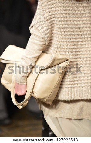 NEW YORK, NY - FEBRUARY 10: Leather bag at the DKNY Fall Winter 2013 Collection during Mercedes-Benz Fashion Week on February 10, 2013, NYC. - stock photo