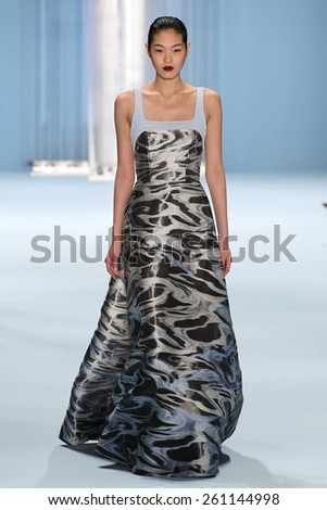 NEW YORK, NY - FEBRUARY 16: Model Chiharu Okunugi walks the runway wearing Carolina Herrera Fall 2015 Collection during MBFW at Lincoln Center on February 16, 2015 in NYC - stock photo