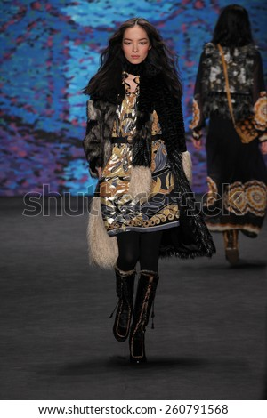 NEW YORK, NY - FEBRUARY 18: Model Fei Fei Sun walks the runway at the Anna Sui fashion show during MBFW Fall 2015 at Lincoln Center on February 18, 2015 in NYC - stock photo