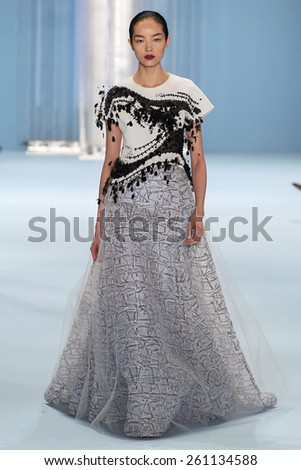 NEW YORK, NY - FEBRUARY 16: Model Fei Fei Sun walks the runway wearing Carolina Herrera Fall 2015 Collection during MBFW at Lincoln Center on February 16, 2015 in NYC - stock photo