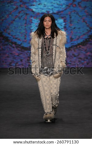 NEW YORK, NY - FEBRUARY 18: Model Liu Wen walks the runway at the Anna Sui fashion show during MBFW Fall 2015 at Lincoln Center on February 18, 2015 in NYC - stock photo
