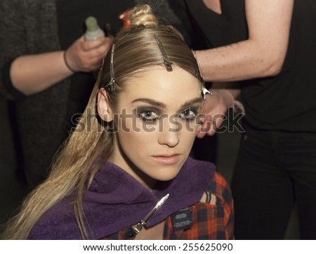 New York, NY - February 14, 2015: Model prepares backstage for PRMITV WORLD presentation at Fall 2015 Fashion Week at Pier 59 Studio