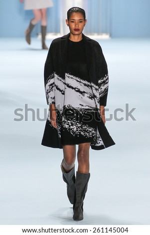 NEW YORK, NY - FEBRUARY 16: Model Sam Rollinson walks the runway wearing Carolina Herrera Fall 2015 Collection during MBFW at Lincoln Center on February 16, 2015 in NYC - stock photo