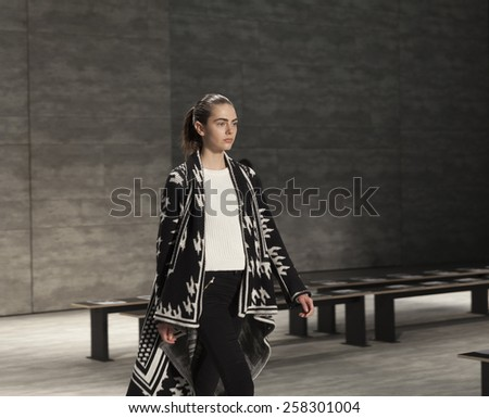 New York, NY - February 14, 2015: Model walks runway during rehearsal for collection by Son Jung Wan at Fall 2015 Fashion Week at Lincoln Center