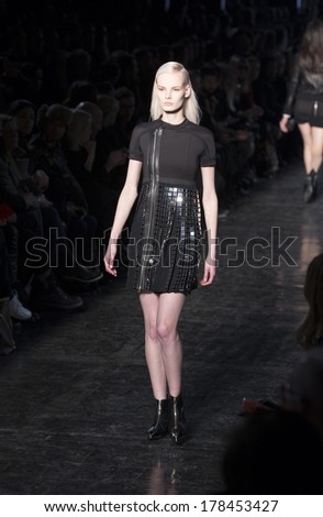 NEW YORK, NY - FEBRUARY 11, 2014: Model walks runway for Diesel Black Gold presentation by Andreas Mlebostad at Fall/Winter 2014 Fashion week at Skylight at Moynihan Station
