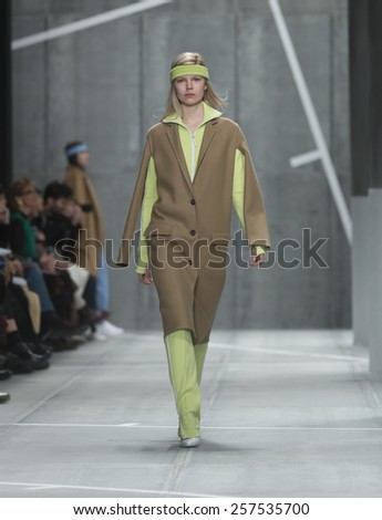 New York, NY - February 14, 2015: Model walks runway for Lacoste collection by Oliveira Baptista during Fall 2015 Fashion Week at Lincoln Center - stock photo