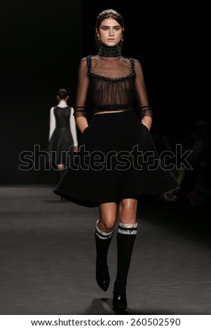 NEW YORK, NY - FEBRUARY 16: Model walks the runway at the Vivienne Tam fashion show during Mercedes-Benz Fashion Week Fall 2015 on February 16, 2015 in NYC.
