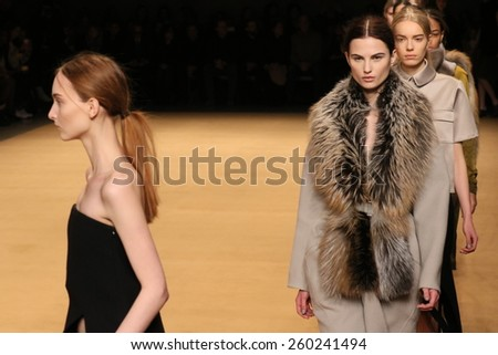 NEW YORK, NY - FEBRUARY 13: Models walk in the Sally LaPointe Fashion show during MBFW Fall 2015 at Skylight Modern on February 13, 2015 in NYC. - stock photo