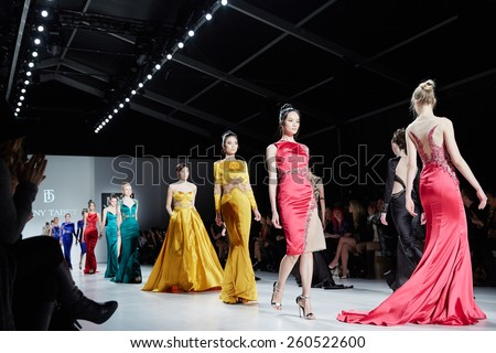 NEW YORK, NY - FEBRUARY 19: Models walk runway in Dany Tabet dress at the New York Life fashion show during MBFW Fall 2015 on February 19, 2015 in NYC. - stock photo