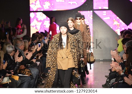 NEW YORK, NY - FEBRUARY 10: Models walk  the runway at the DKNY Fall Winter 2013 fashion show during Mercedes-Benz Fashion Week on February 10, 2013, NYC. - stock photo