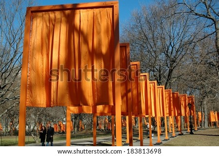 New York, NY - February 13, 2005: People strolling under artist Christo's art installation The Gates in Central Park  - stock photo