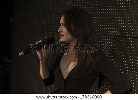 NEW YORK, NY - FEBRUARY 11, 2014: Singer Tara Moran performs on runway for Dinner with Edward presentation by Malan Breton at Fall/Winter 2014 Fashion week at 510 West 42nd street